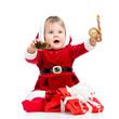 happy baby in Santa Claus clothes