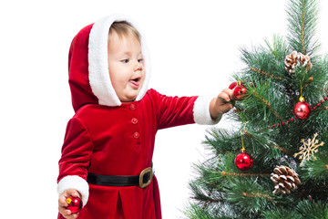 kid girl decorating Christmas tree