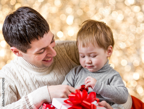 father and son with gift over festival background