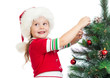 child girl decorating Christmas tree isolated