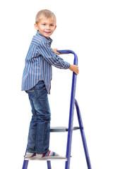 Boy is standing on ladder