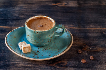 Сup of espresso coffee with sugar on vintage wooden background