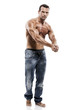 Muscle man posing in studio, isolated over a white background
