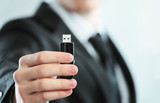 Flash drive in hand - 57712246