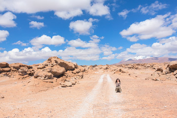 Woman catches the car at deserted road, Bolivia