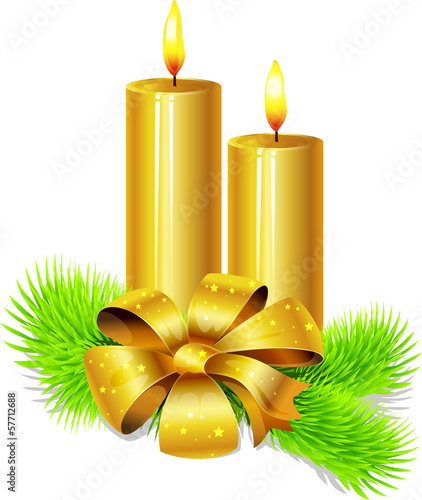 golden candle with bow decoration and fir twig