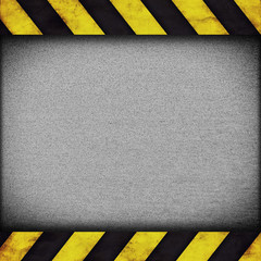 Warning stripes background with rusty plate