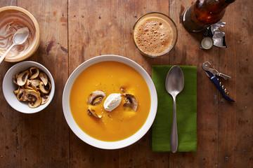 Pumpkin cream dinner on wooden table
