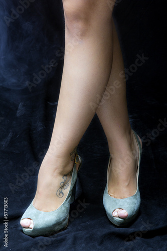 Female legs and feet with dress shoes color image