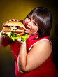 Woman eating hamburger.