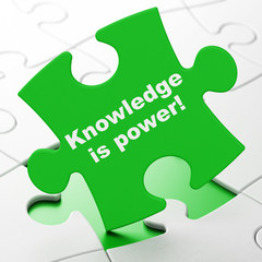 Education concept: Knowledge Is power! on puzzle background