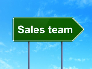 Marketing concept: Sales Team on road sign background