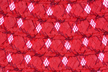 A very close view of red straw and netting