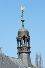 Octagonal belfry with clocks and weathercock