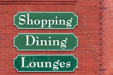 Signs on the brick wall of Saint John Market, New Brunswick