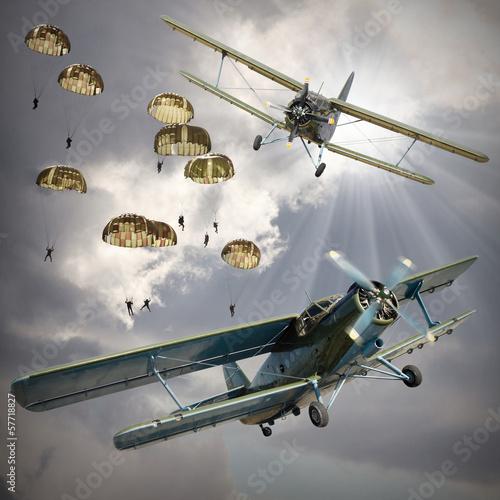 Leinwandbild Motiv Retro style picture of the biplanes with airborne infantry.