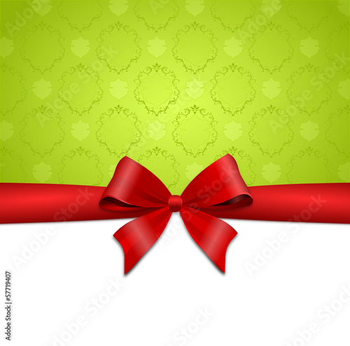 Rote Schleife mit grünem Geschenkpapier