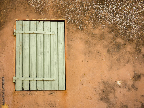 Old window on ocher wall