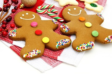 Gingerbread Men and candy canes on checked cloth