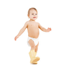 cute little boy walking in big rubber boots
