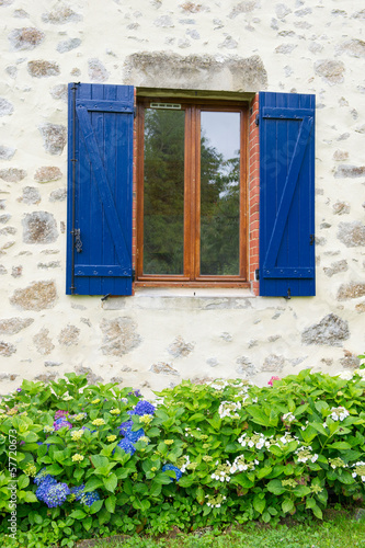 French window with shutters