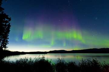 Summer night Northern lights over Lake Laberge