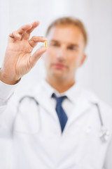 doctor with pill in hospital