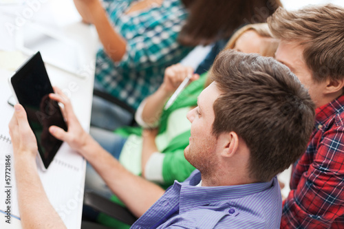 students looking at tablet pc at school