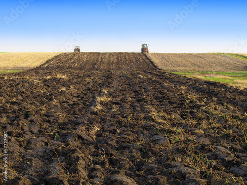 Tractor Plowing in Autumn