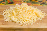 Grated cheese on a cutting board