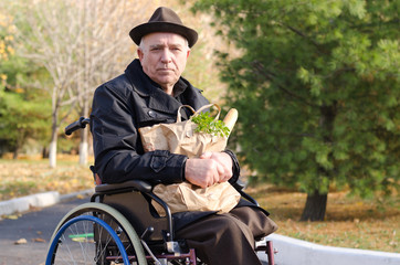 Handicapped man doing his grocery shopping