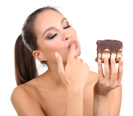 Portrait of beautiful young girl with chocolate cupcake