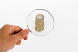 Magnifying Glass Focused on Coins