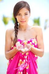 Beautiful serene woman on beach in sarong