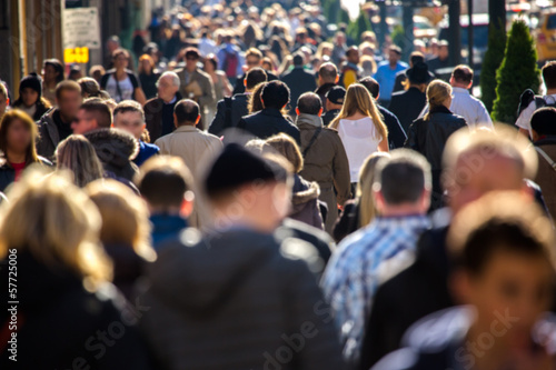 Anonymous crowd walking on a street in New York - 57725006