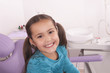 little girl smiling in the dentist chair