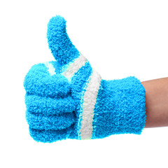 thumb up. hand in knitted blue gloves isolated