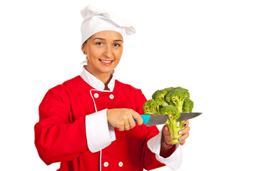 Chef cutting broccoli