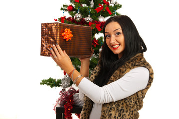 Happy woman showing Christmas gift