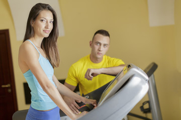 Young man and woman in the gym