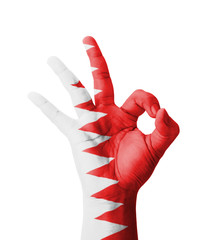 Hand making Ok sign, Bahrain flag painted