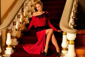 Beautiful young woman in long evening dress