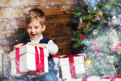 Happy little boy with gift box