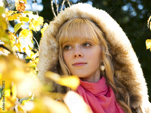Beautiful blond girl in autumn park