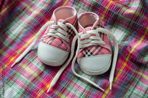 Pair of sneakers on colorful fabric
