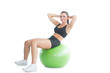 Gorgeous active woman practicing an exercise on an exercise ball