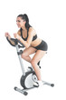 Pretty active woman training on an exercise bike