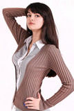 Portrait of beautiful brunette business lady posing in office