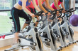 Mid section of people working out at spinning class
