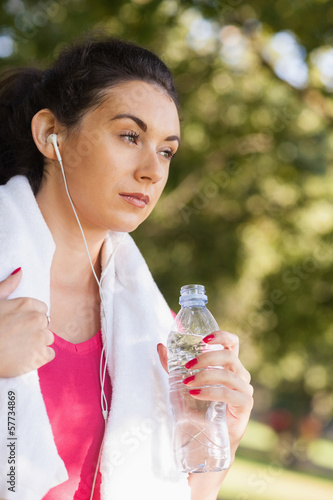 Thoughtful brunette woman having a break